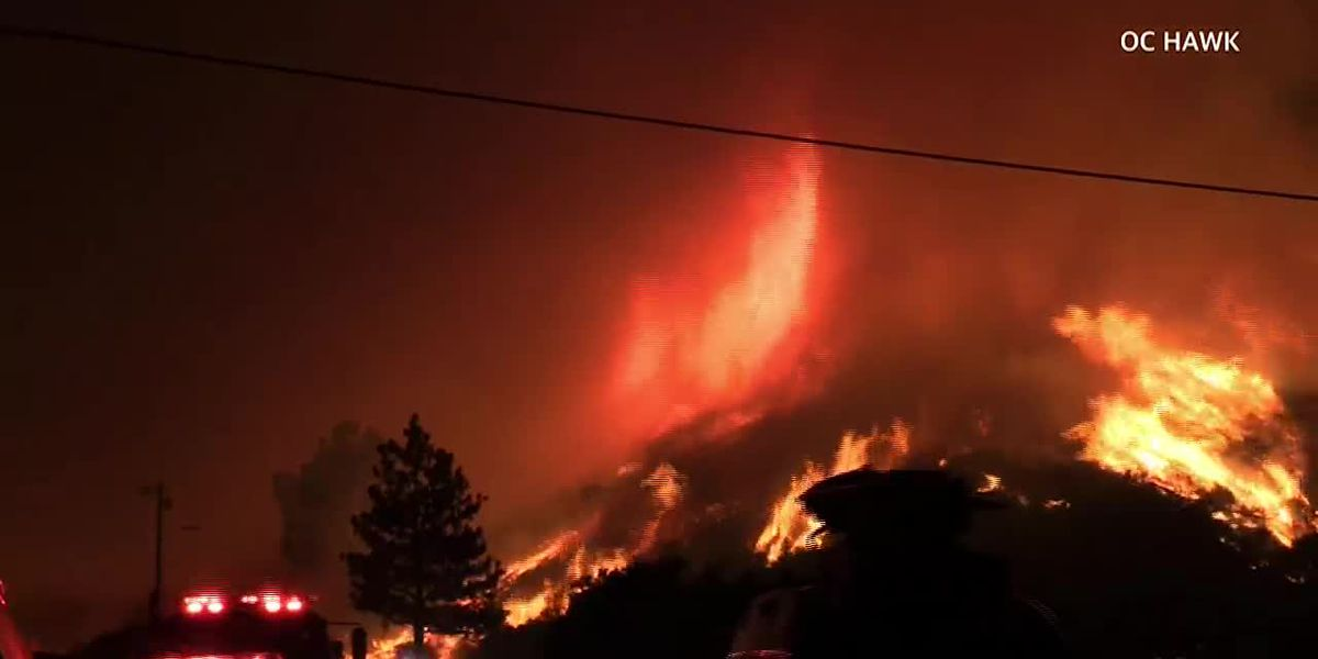 Crews try to tame California wildfire as heat wave arrives