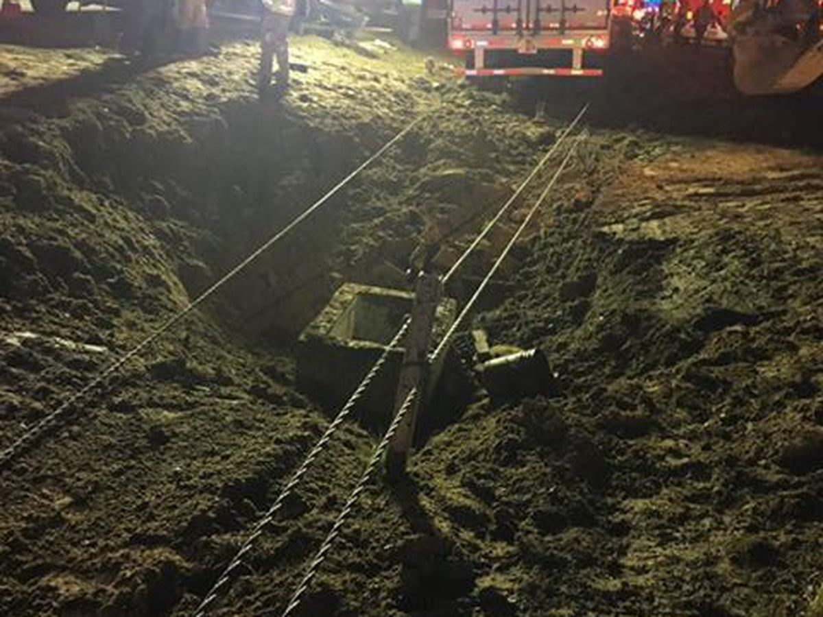 Four injured after 18-wheeler runs over drainage pit on I-95 that workers were in