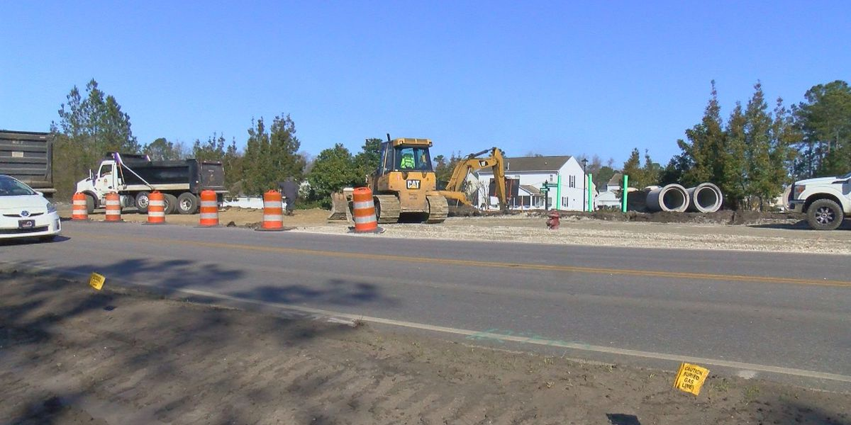 Crews laying asphalt for Carolina Forest Boulevard widening project