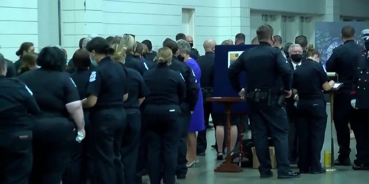 'We're here to honor': Hundreds line up to pay their respects to fallen MBPD officer at viewing