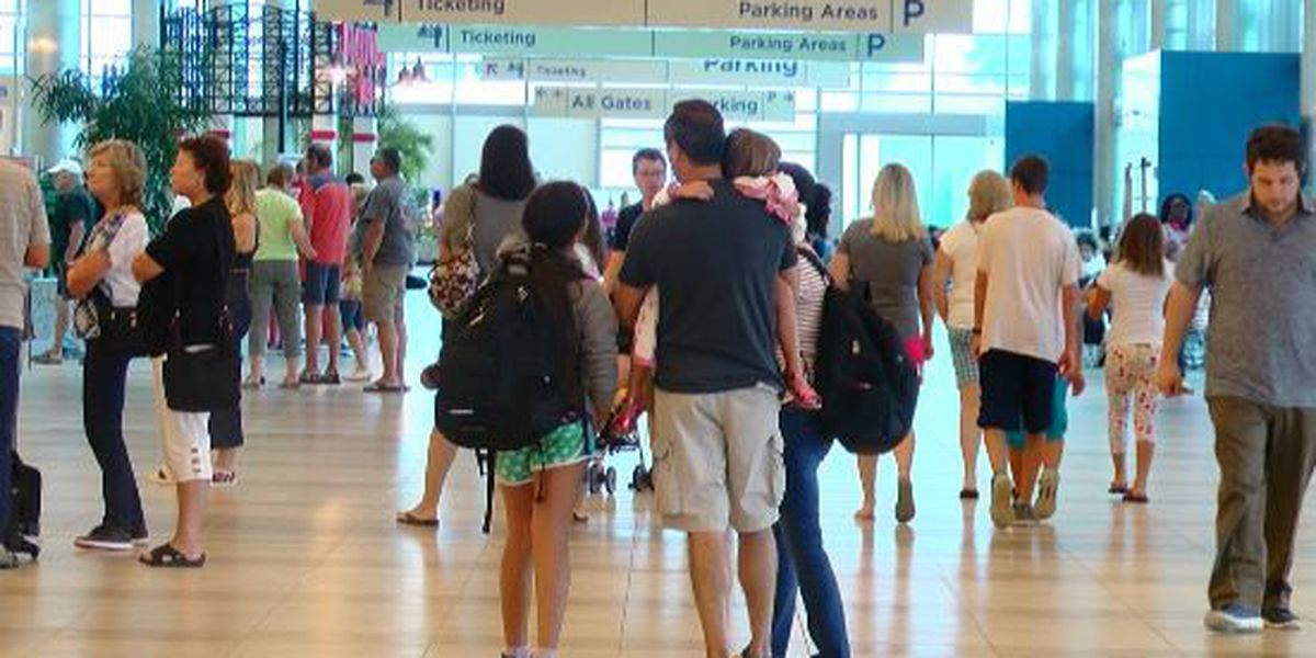 Passengers take on the holiday crowds at the Myrtle Beach International Airport