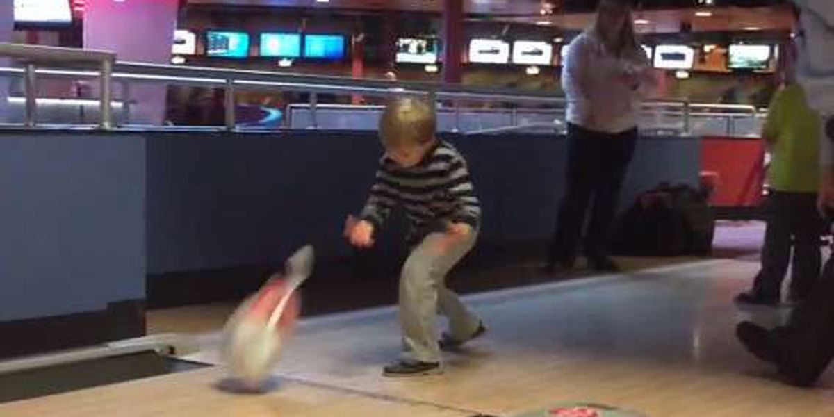 (VERY) RAW VIDEO: Bowlers toss frozen turkeys for charity