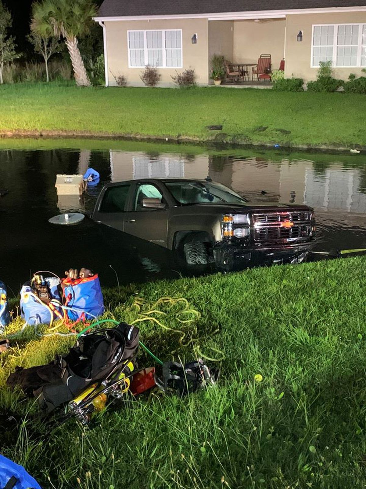 Dive Team Removes Submerged Truck From Retaining Pond In