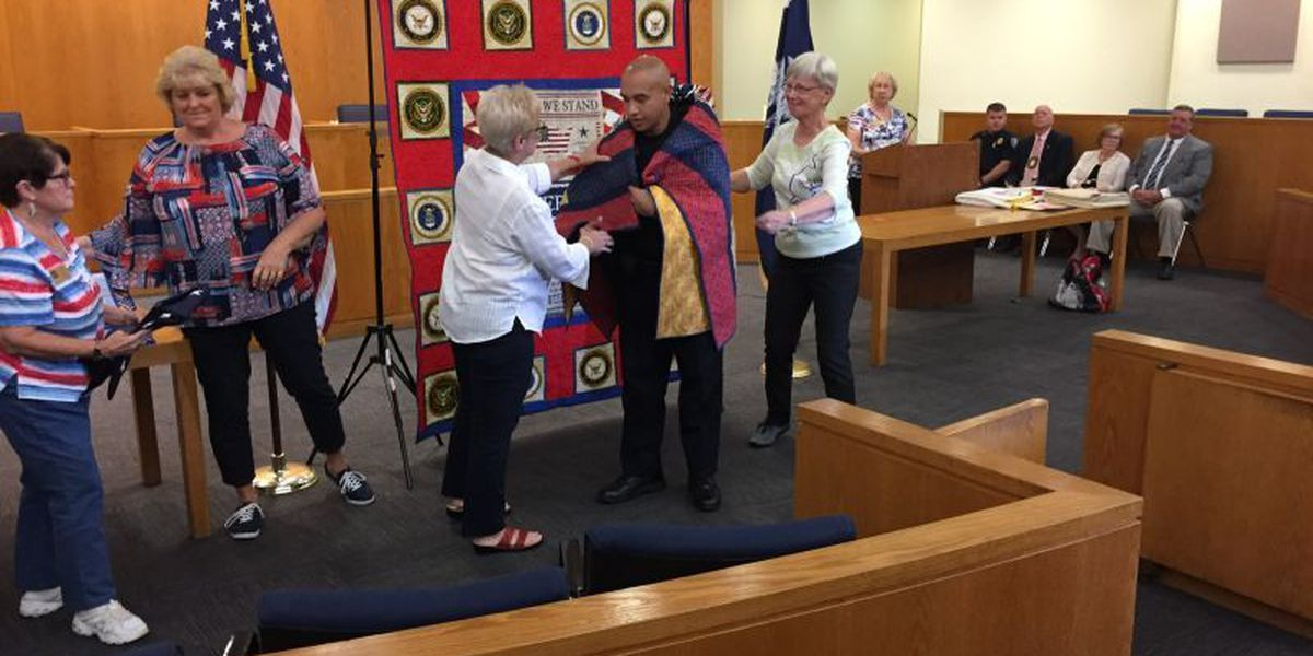 Myrtle Beach Police personnel who served in armed forces presented handmade 'Quilts of Valor'