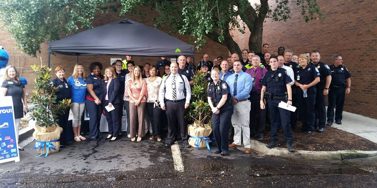 Bank employees thank officers with breakfast; department donates trees to deadly bank robbery victims' families