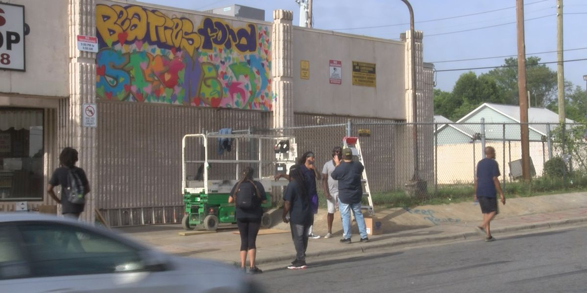 Artists paint mural on Beatties Ford Road to lift spirits after deadly shooting