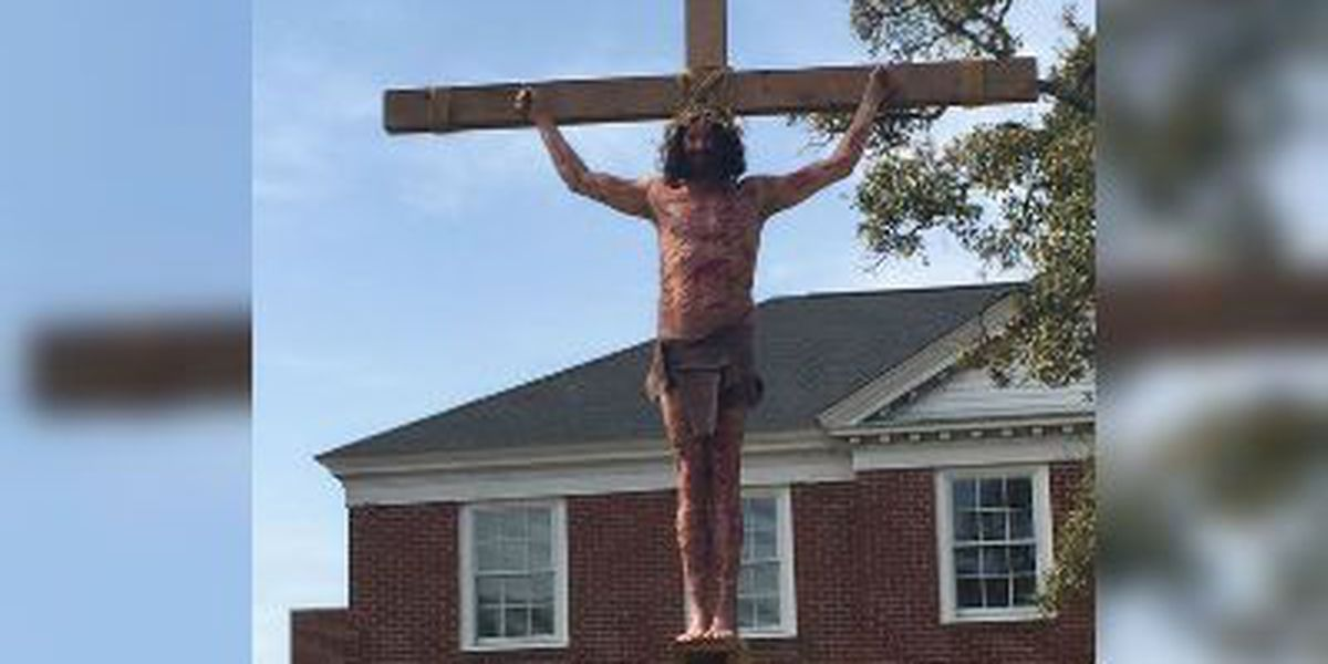 Man 'hanging' from cross has many doing a double-take