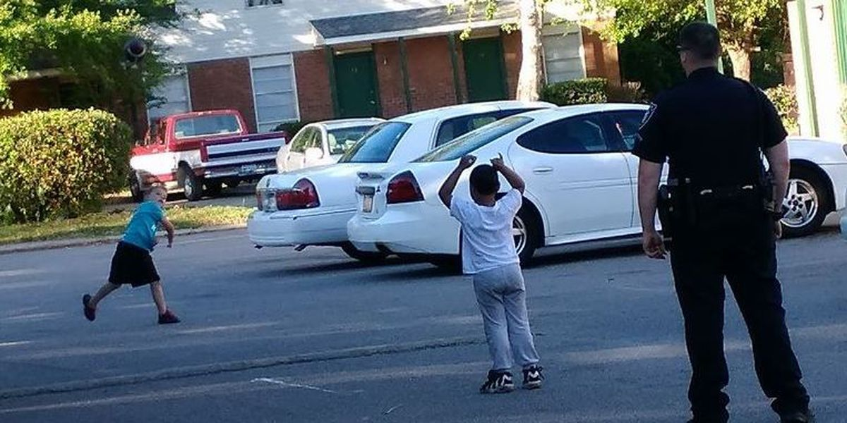 Myrtle Beach police officer stops to toss pigskin with 2 kids