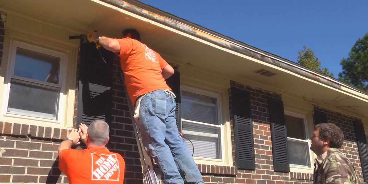 Volunteers prepare reintegration house for homeless veterans