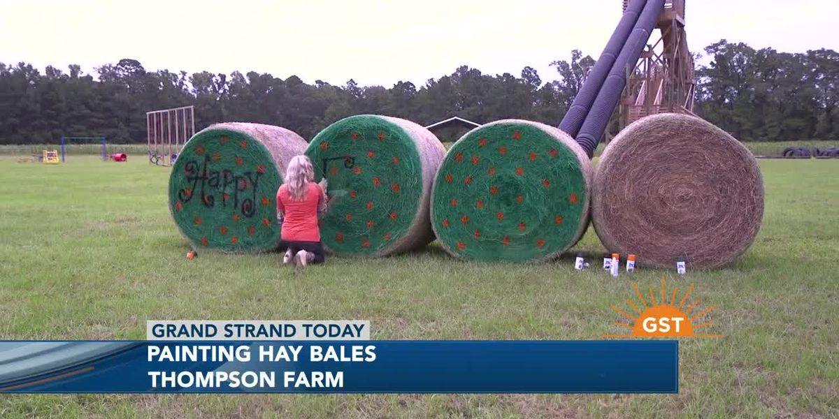 Painting hay bales at Thompson Farms