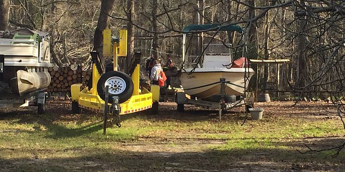 Neighbors try to save woman after she drives her car into the Waccamaw River