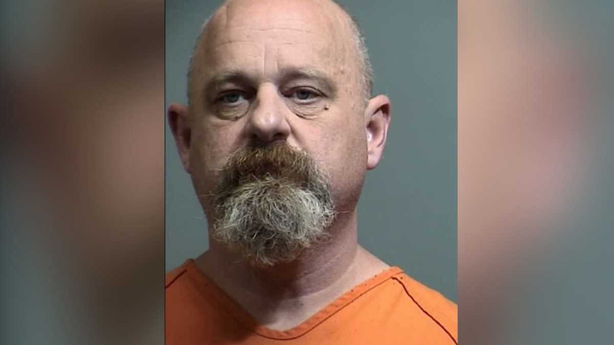 Former police chief accused of robbing bank in GCSO custody