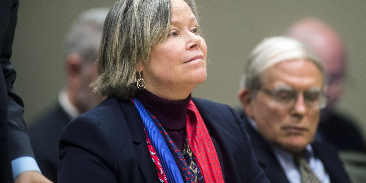 Michigan's medical chief to stand trial on Flint charges