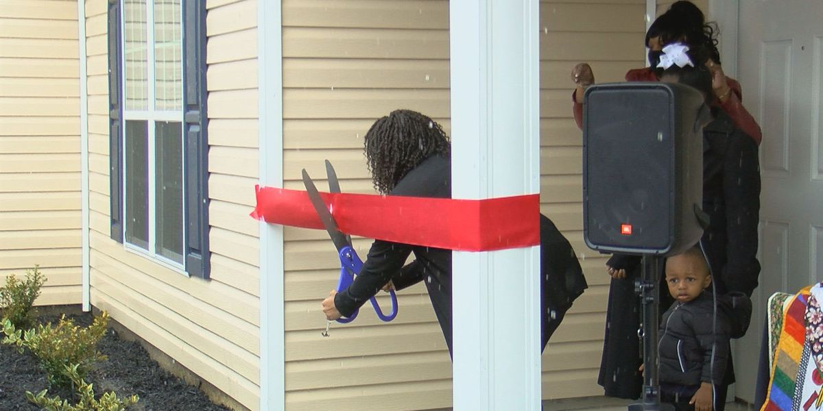 Woman receives new home after finishing Habitat for Humanity program
