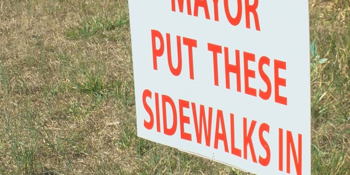 'Mayor Put These Sidewalks In' signs seen in Conway