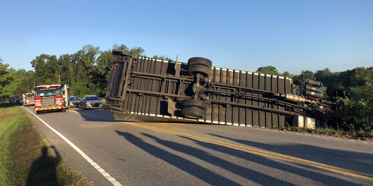 Lanes of Highway 57 near state line closed after truck overturns
