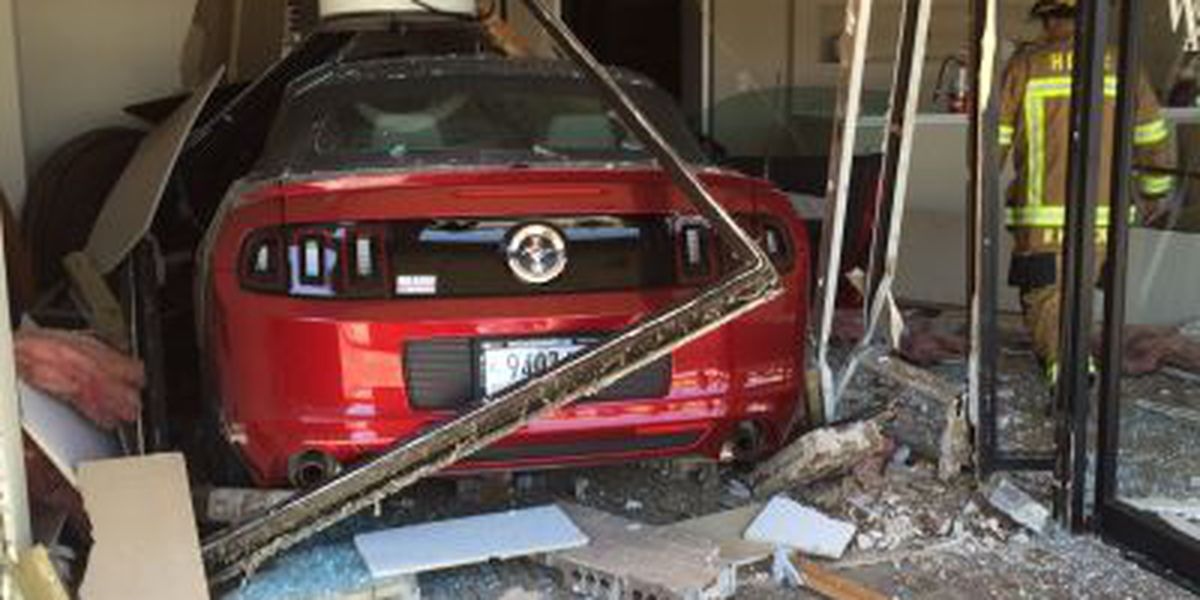 Fire crews respond after car crashes into Myrtle Beach real estate office