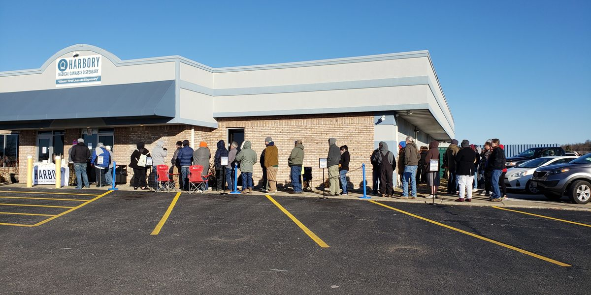 """It's a historical moment."" Dozens wait in line to buy recreational pot in Illinois"