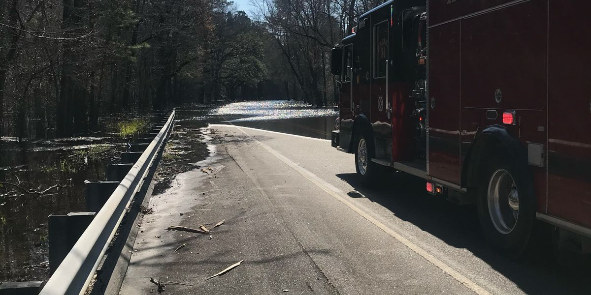 Crews respond after vehicle gets caught in floodwaters in Longs