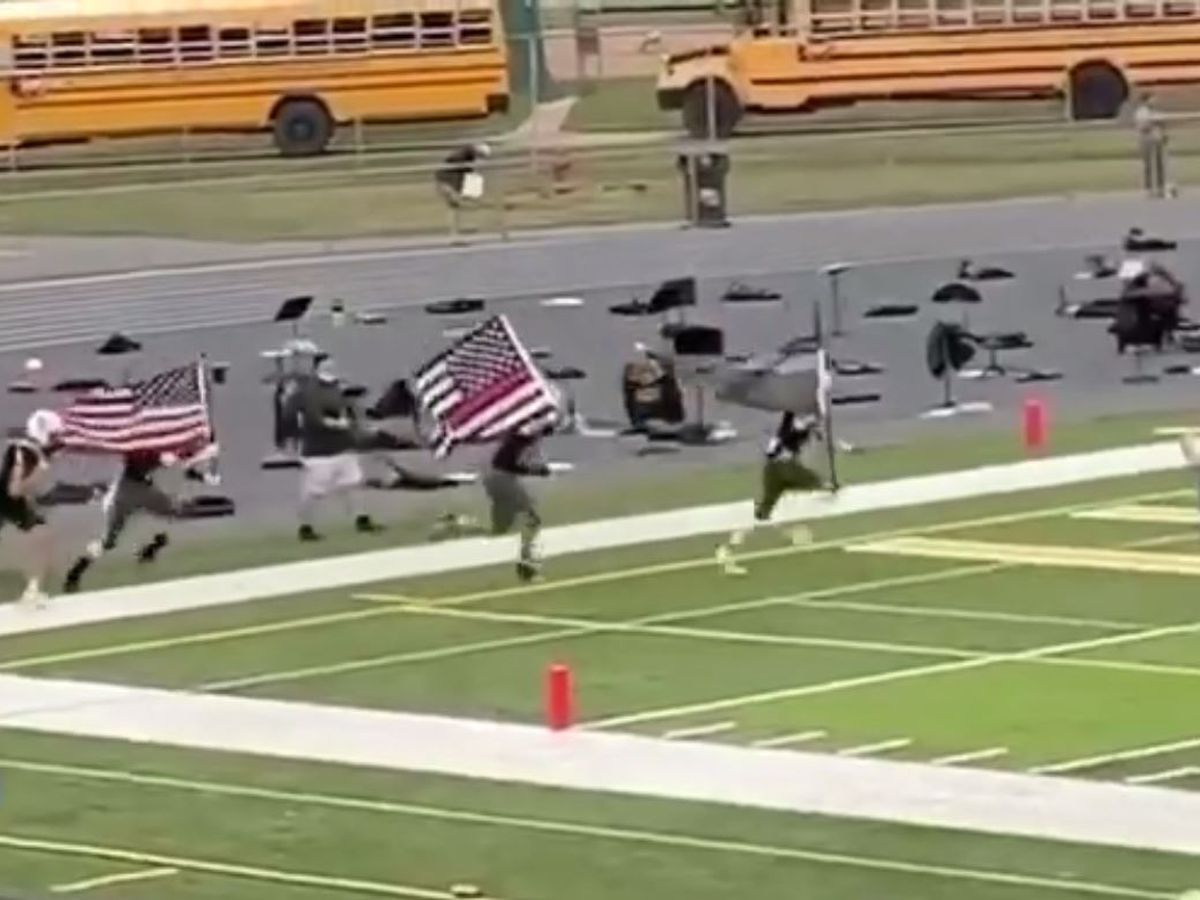 'True Patriots': Scholarship awarded to football players who carried police, fire flags on field