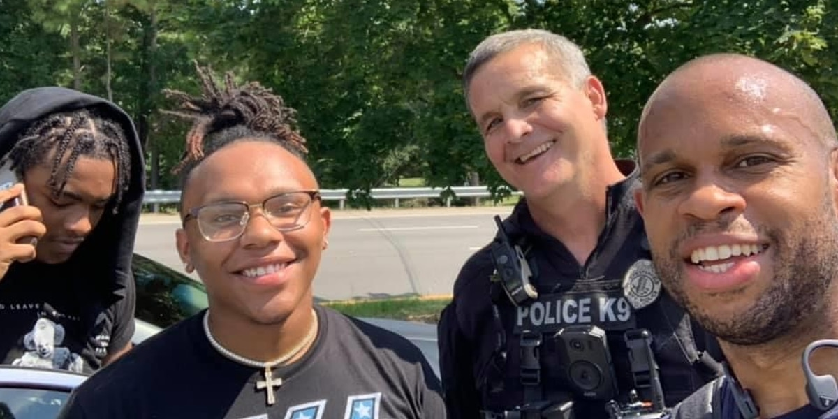 Chesterfield officer, pastor stop to help 2 men change flat tire