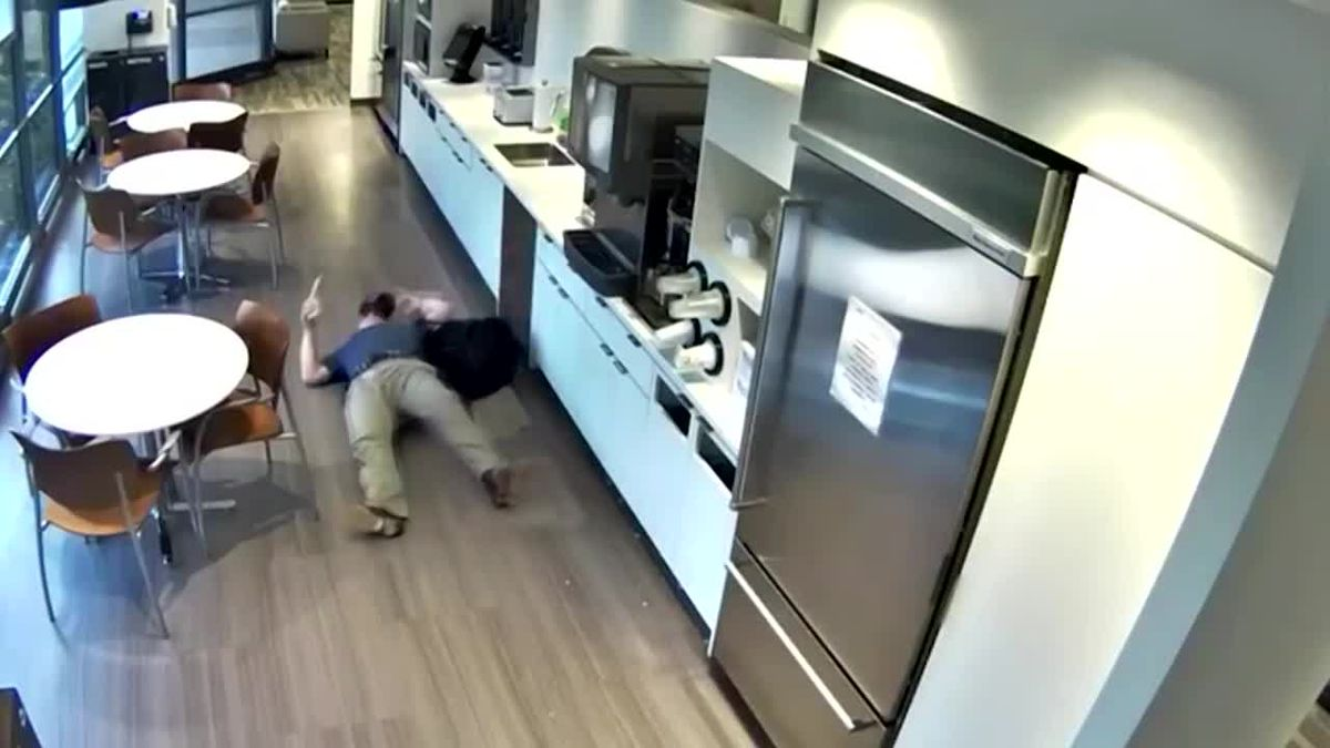 Video: Man appears to throw ice, fake fall in office for insurance money