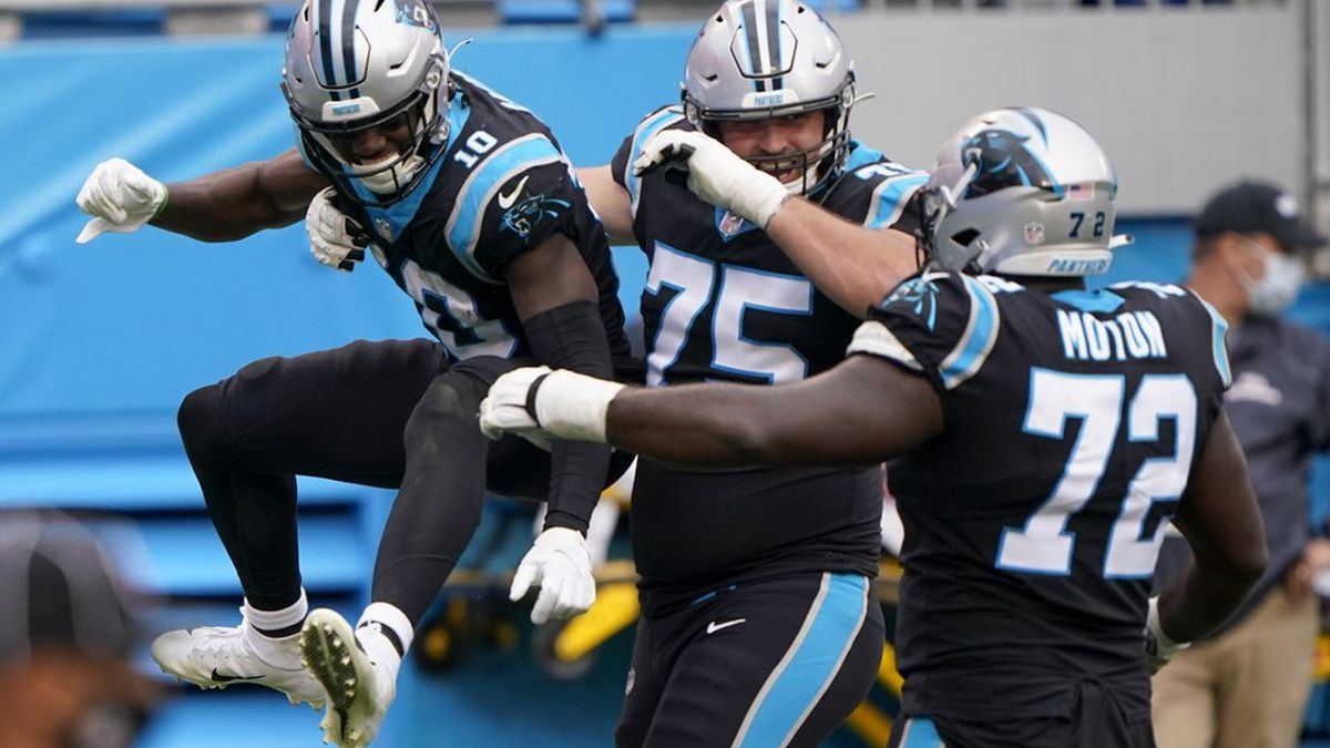 Walker wins first NFL start as Panthers blank Lions 20-0