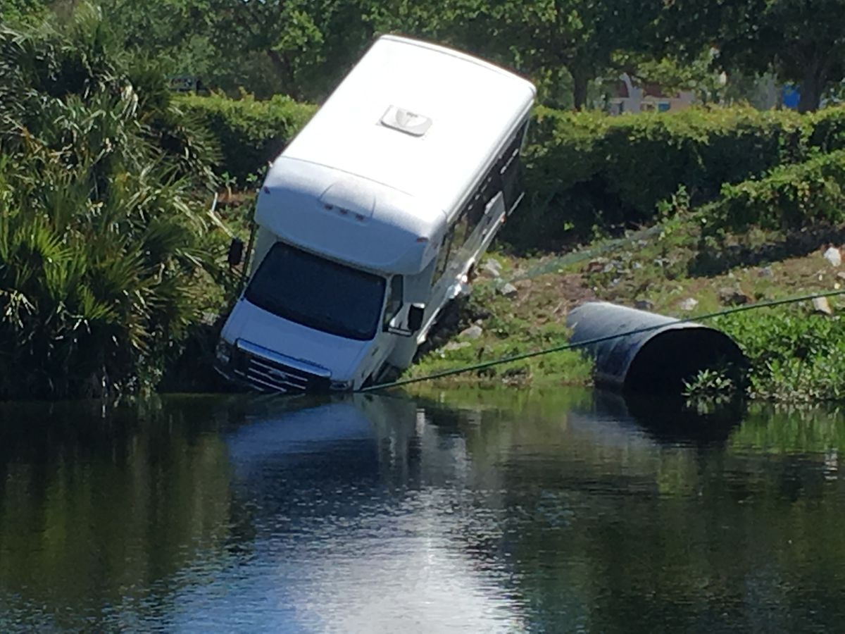 Bus drives into retention pond near old Myrtle Square Mall site