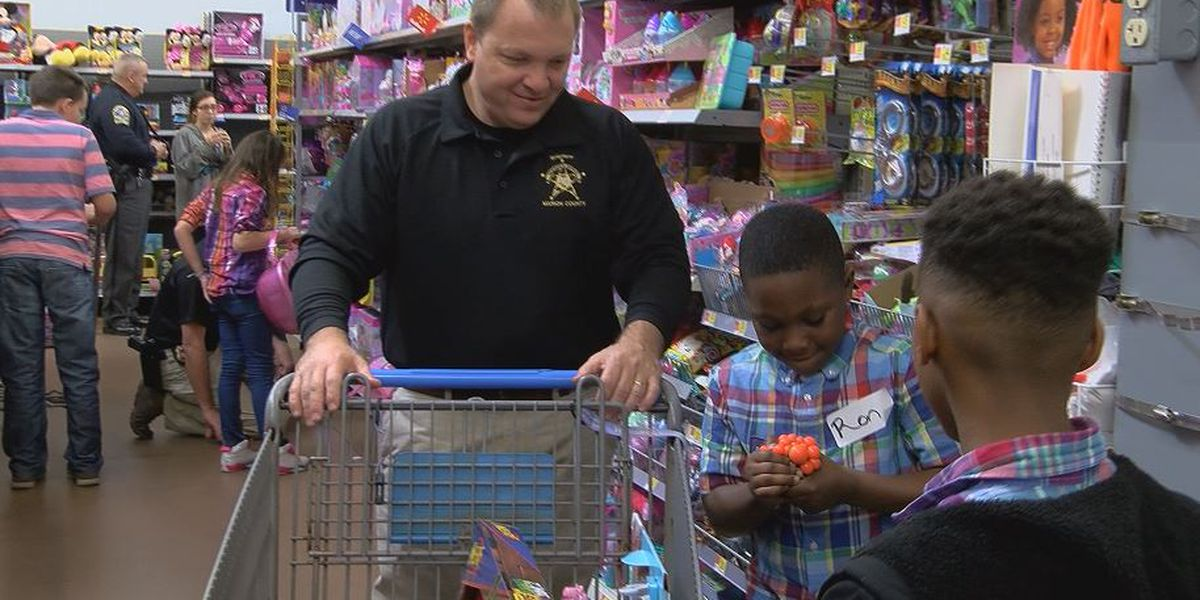 Officers take kids on a shopping spree during Shop with a Cop event