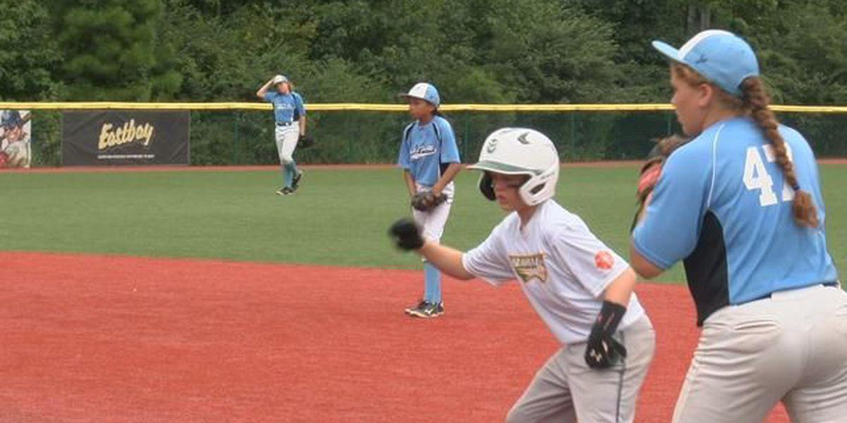 National all-star girls' baseball team challenging boys
