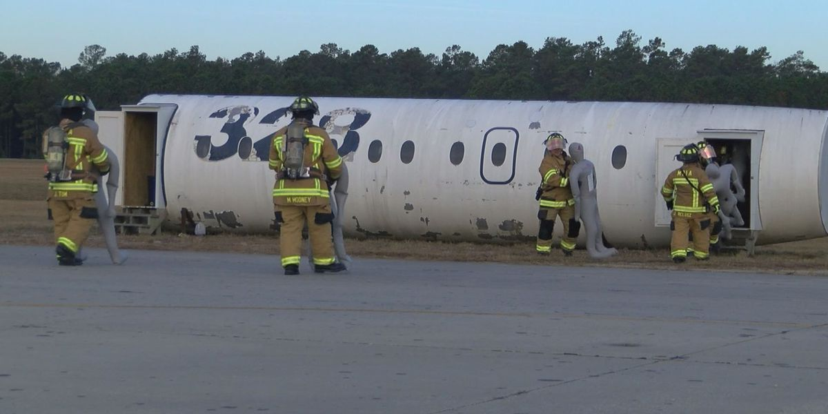 Emergency responders act out mock plane crash for exercise at MYR