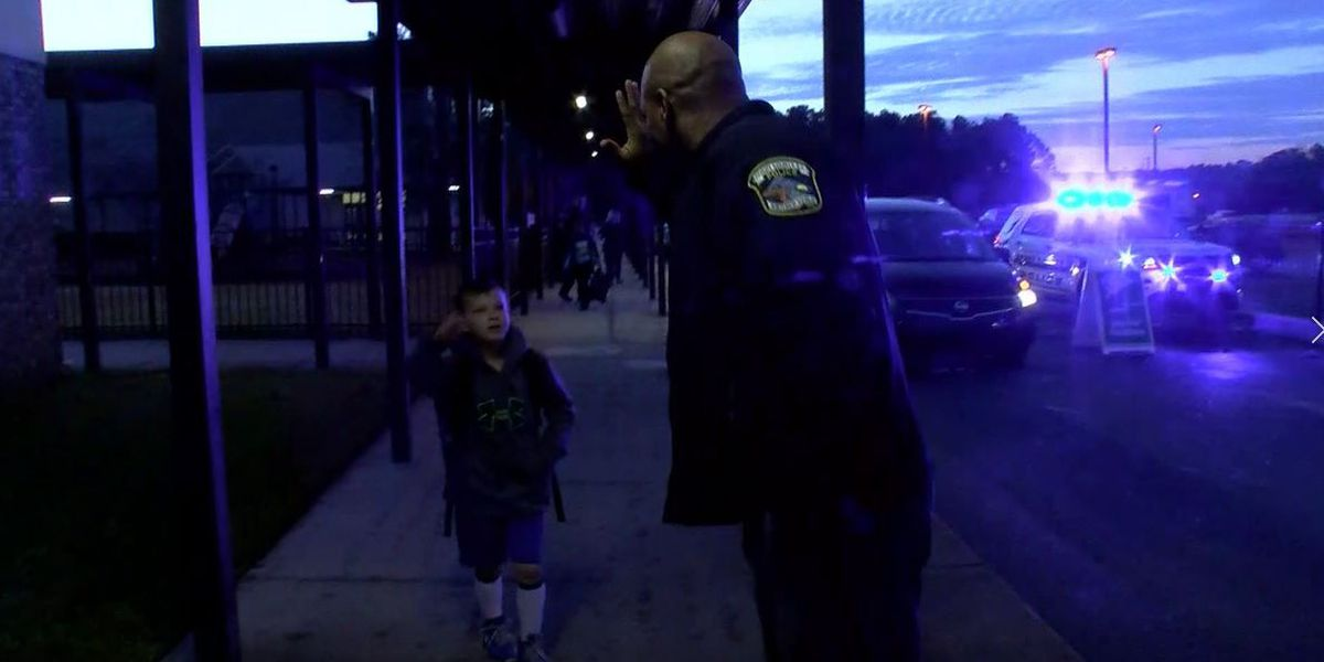Police strengthen relationship with students through high-fives
