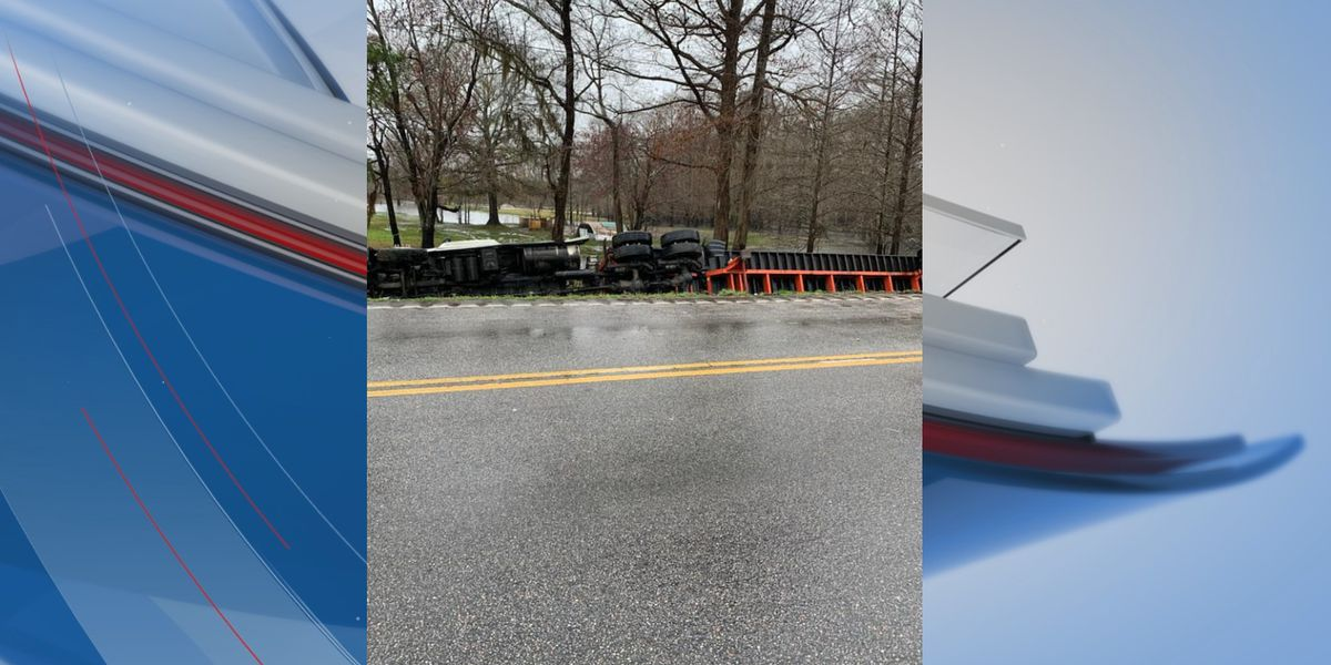 18-wheeler overturns into ditch in Conway