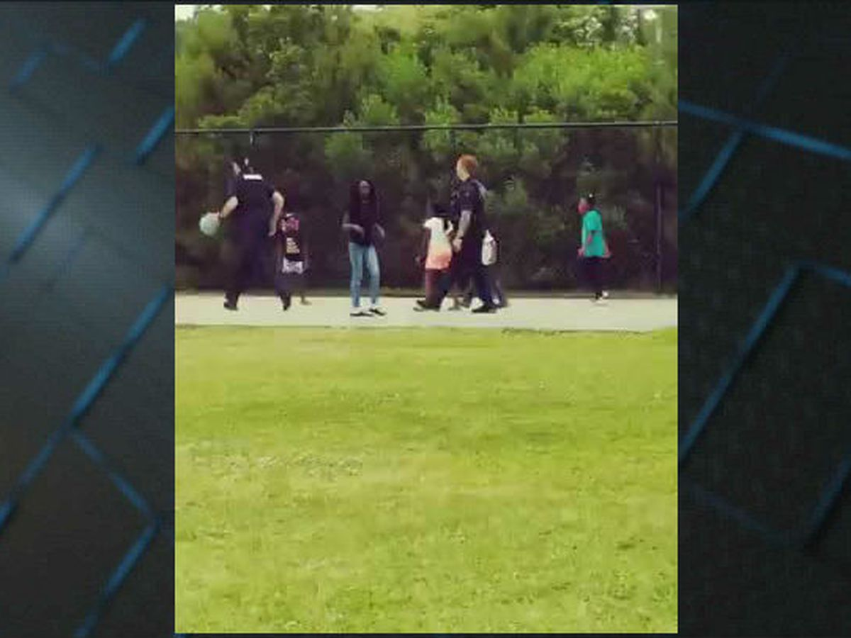Myrtle Beach officers show neighborhood kids their skills on the basketball court