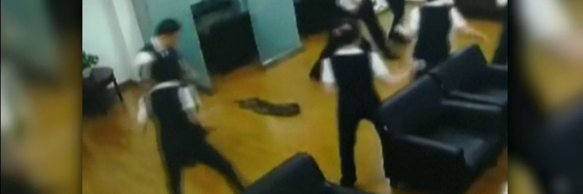 VIDEO: Huge python falls from ceiling during meeting