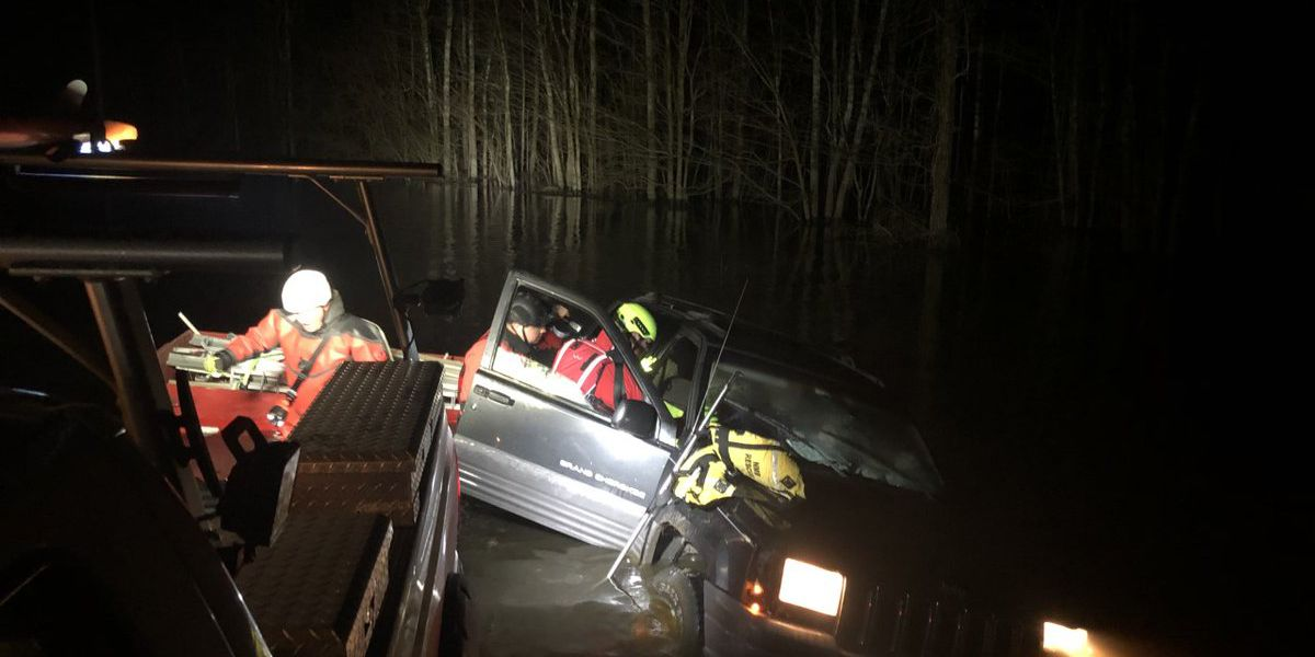 One injured after car gets trapped in water in Longs area
