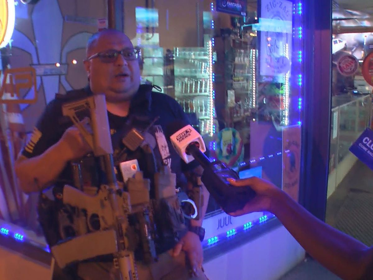 Small business owner arms himself in front of Louisville shop