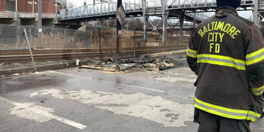 Man killed when 3 portable bathrooms catch fire in Baltimore