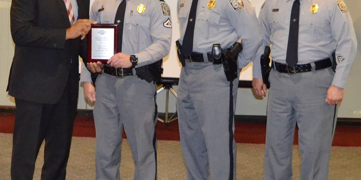 Highway Patrol troopers honored at the 2014 Trooper/TCO of the Year ceremony