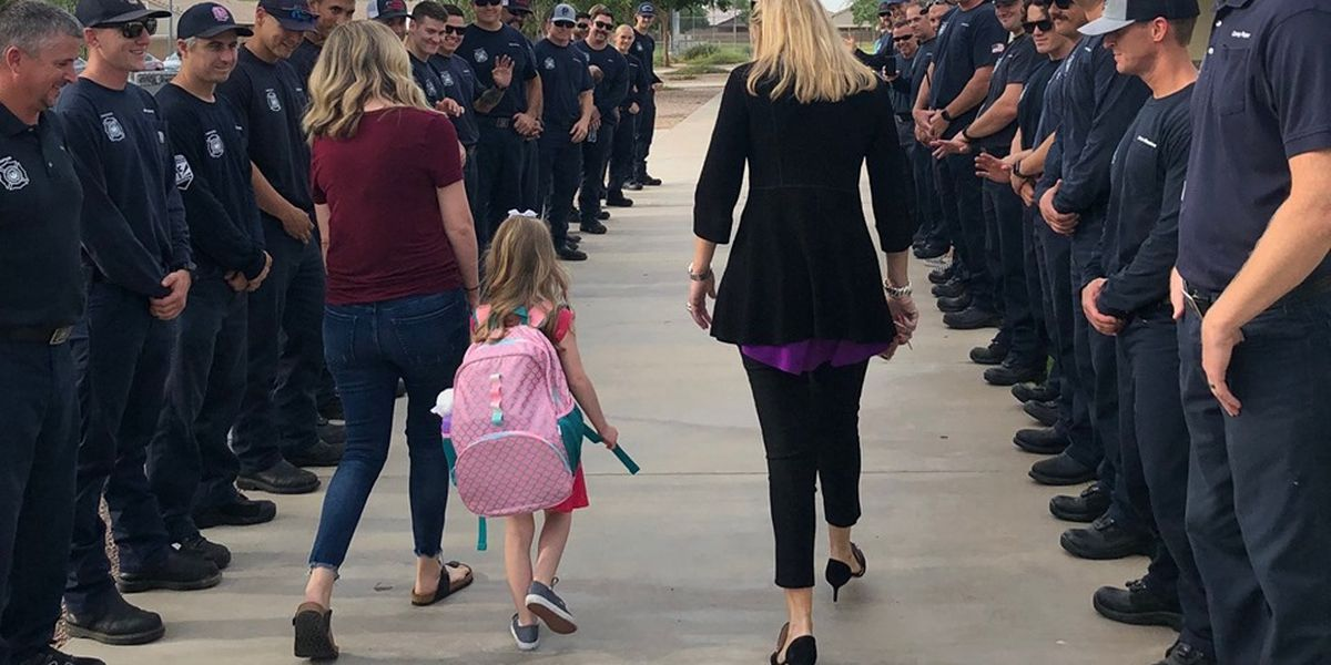 Firefighters stand in for fallen comrade on daughter's first day of school