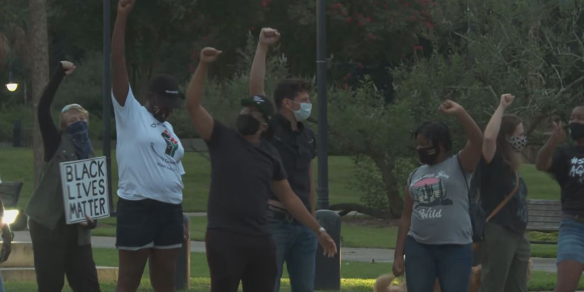 Protesters learn of CPD officer's firing during demonstration calling for his termination