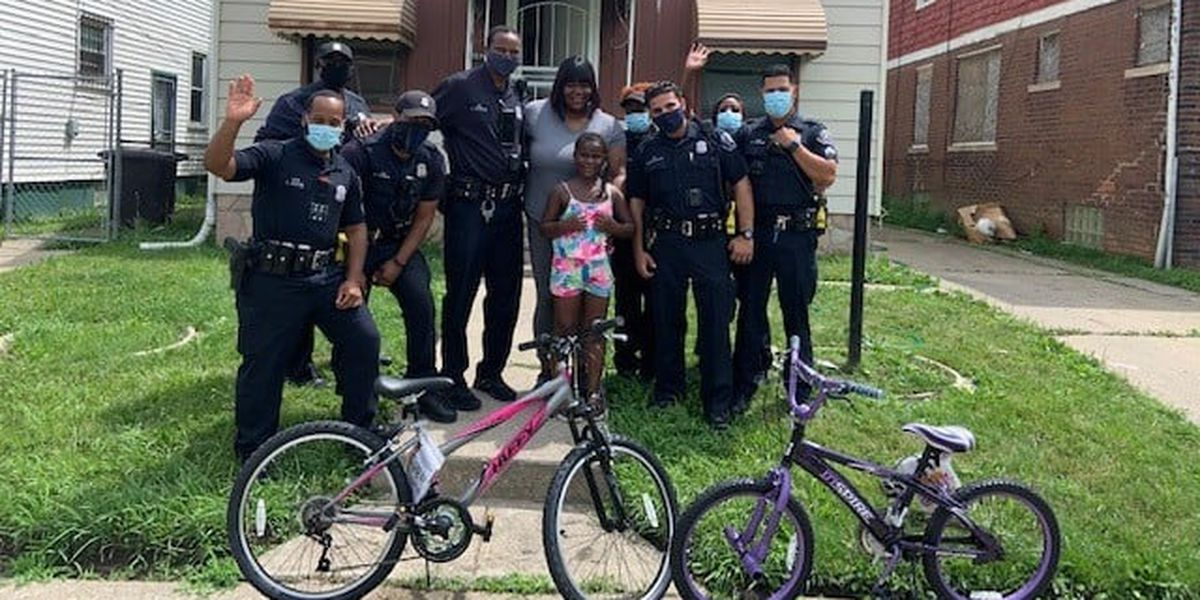 Police officers get 2 new bikes for sisters sharing 1