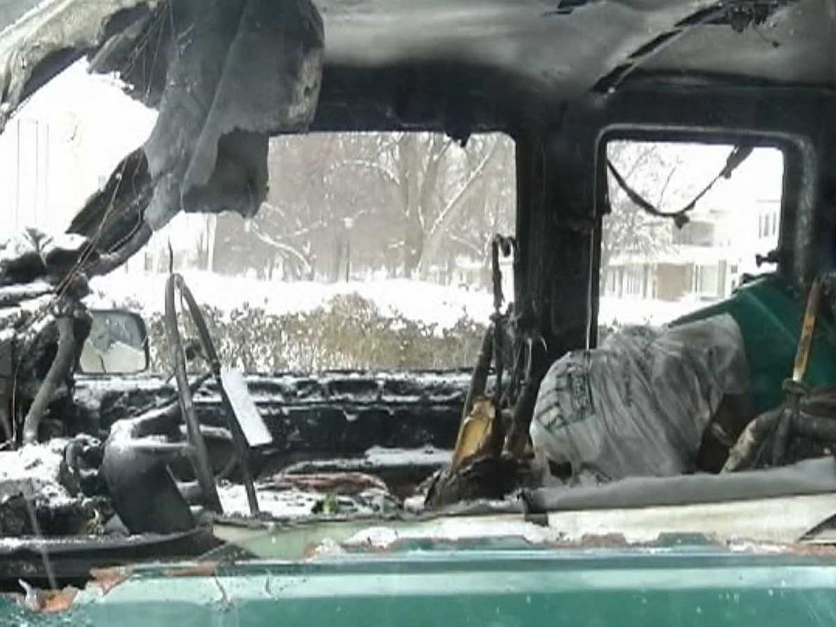 Men pull disabled driver to safety after plow truck catches fire