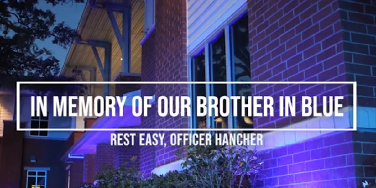 Conway police light up public safety building in blue to honor Ofc. Hancher