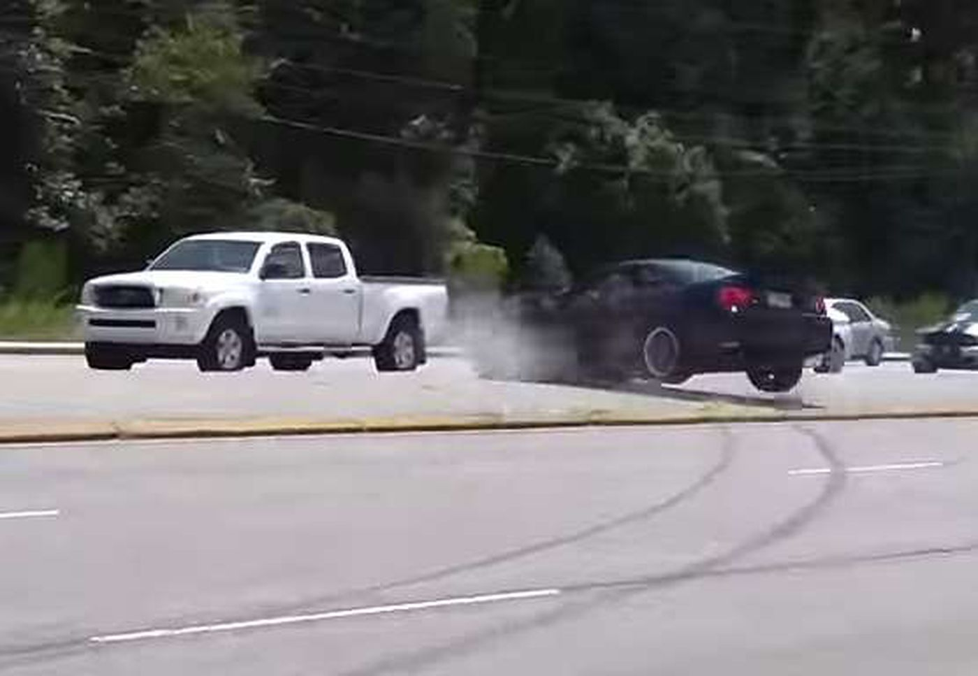 A Video On You Shows Black Mustang Lose Control And Jump Curb Into Oncoming