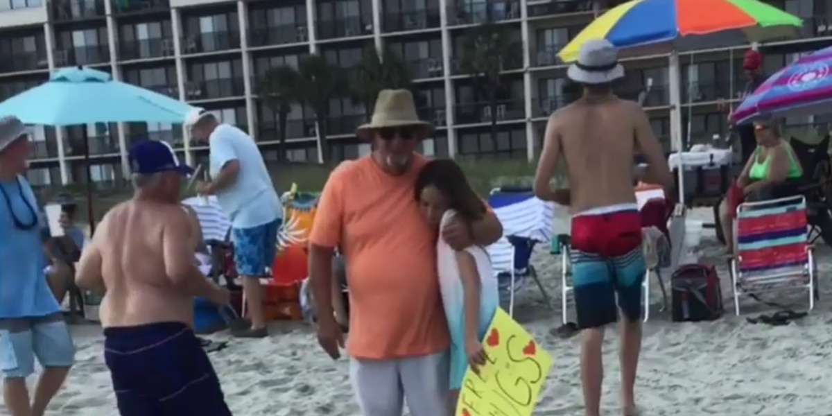 'Love wins:' 10-year-old offers free hugs on S.C. beach to spread kindness