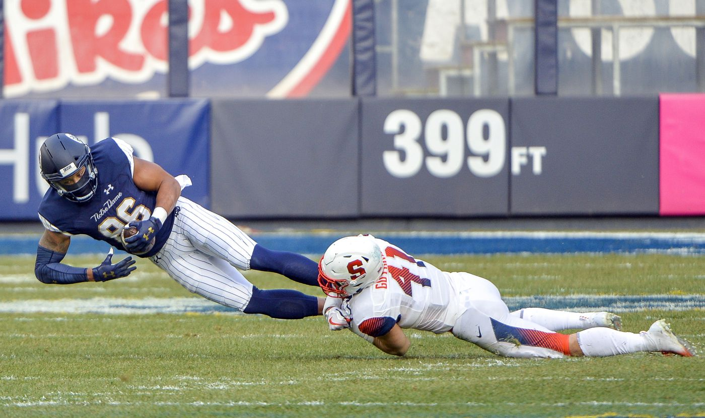 f4fe1fd58 Syracuse linebacker Ryan Guthrie (41) tackles Notre Dame tight end Alize  Mack (86