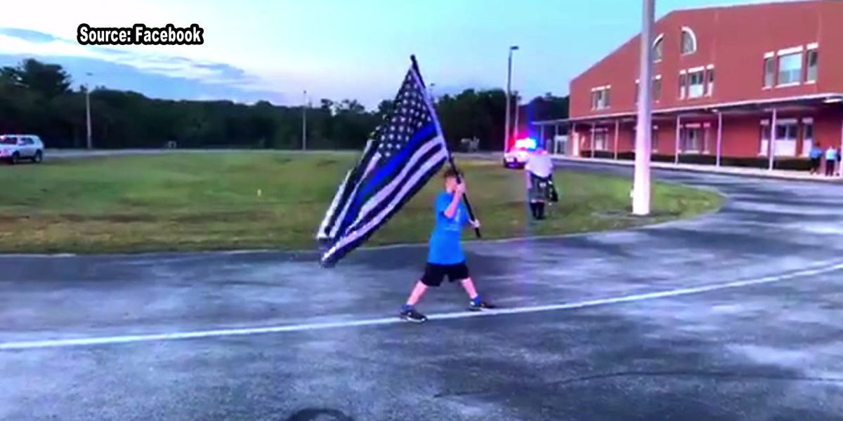 Boy runs mile in honor of Officer Cousette