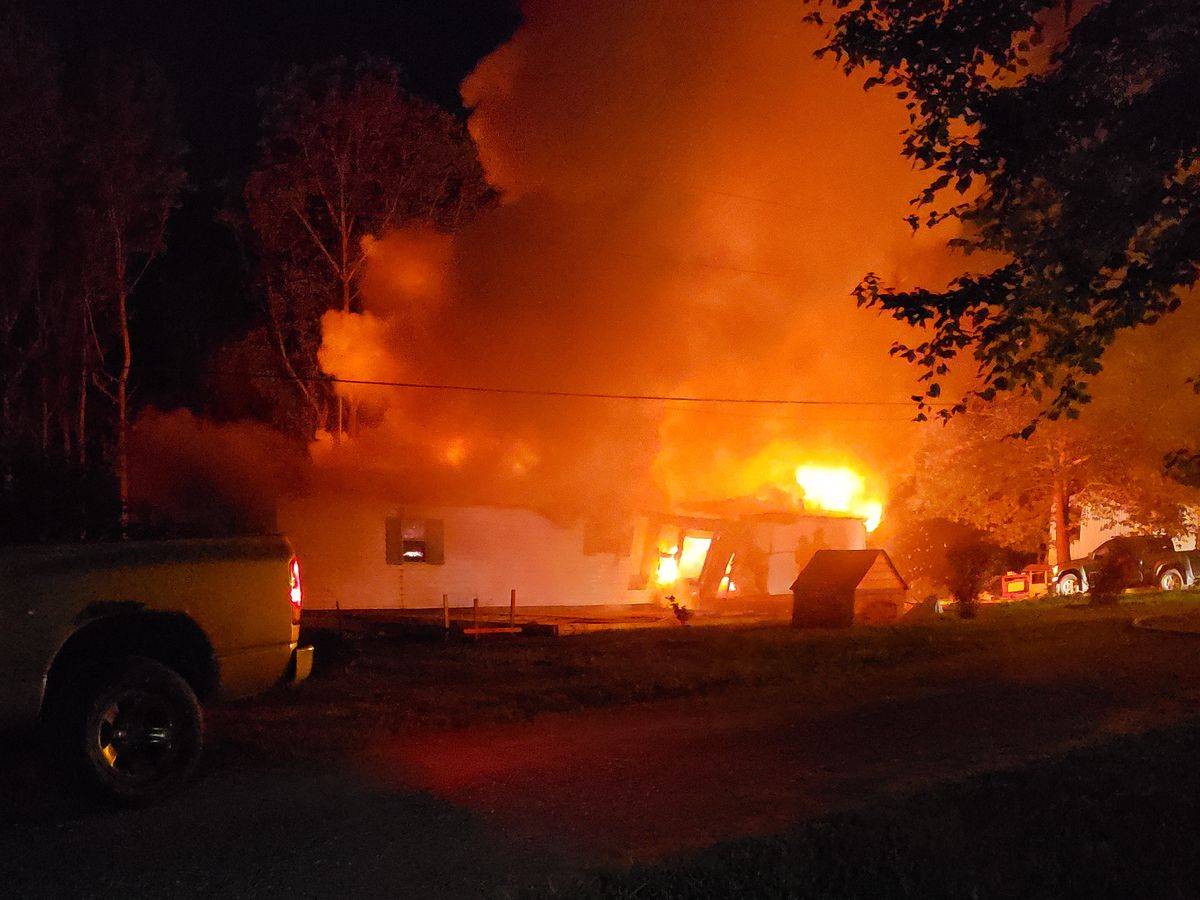 Investigators: House set ablaze in NC, killing two people and leaving one missing