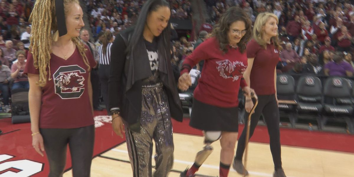 Chapin woman who lost leg in boating accident walks across the court with Coach Dawn Staley